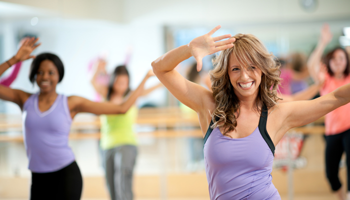 A fitness dance group class at the gym